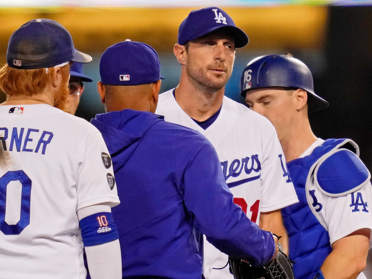 Los Angeles Dodgers starting pitcher Max Scherzer (31) reacts as manager Dave Roberts (30) takes him out of the game against the St. Louis Cardinals during the fifth inning at Dodger Stadium.