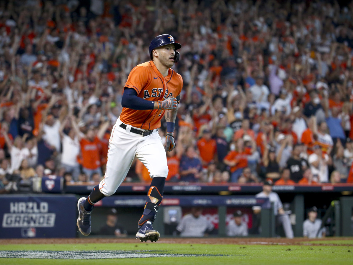 Oct 8, 2021; Houston, Texas, USA; Houston Astros shortstop Carlos Correa (1) hits a double and drives in a run against the Chicago White Sox during the seventh inning in game two of the 2021 ALDS at Minute Maid Park.