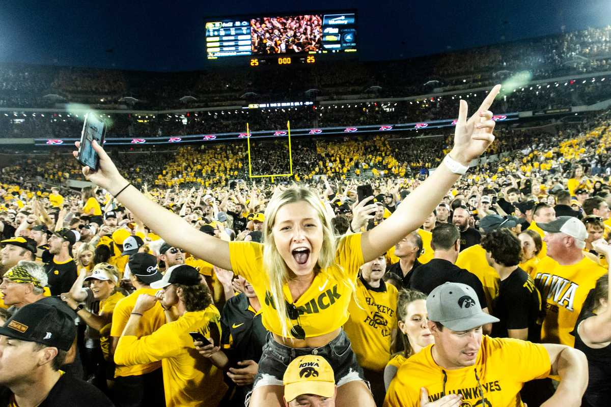 Iowa fans celebrate their team's 23-20 win over Penn State at Kinnick Stadium. (Joseph Cress/Iowa City Press-Citizen)