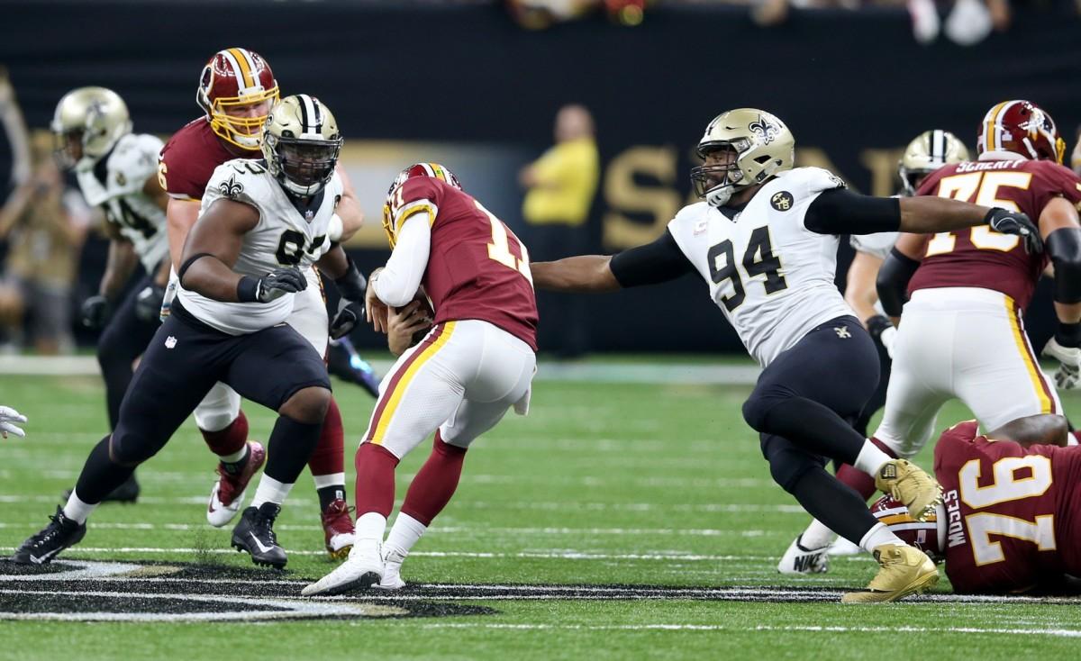 New Orleans Saints defensive ends Marcus Davenport (92) and Cameron Jordan (94) pressure Washington Redskins quarterback Alex Smith (11). Mandatory Credit: Chuck Cook-USA TODAY Sports