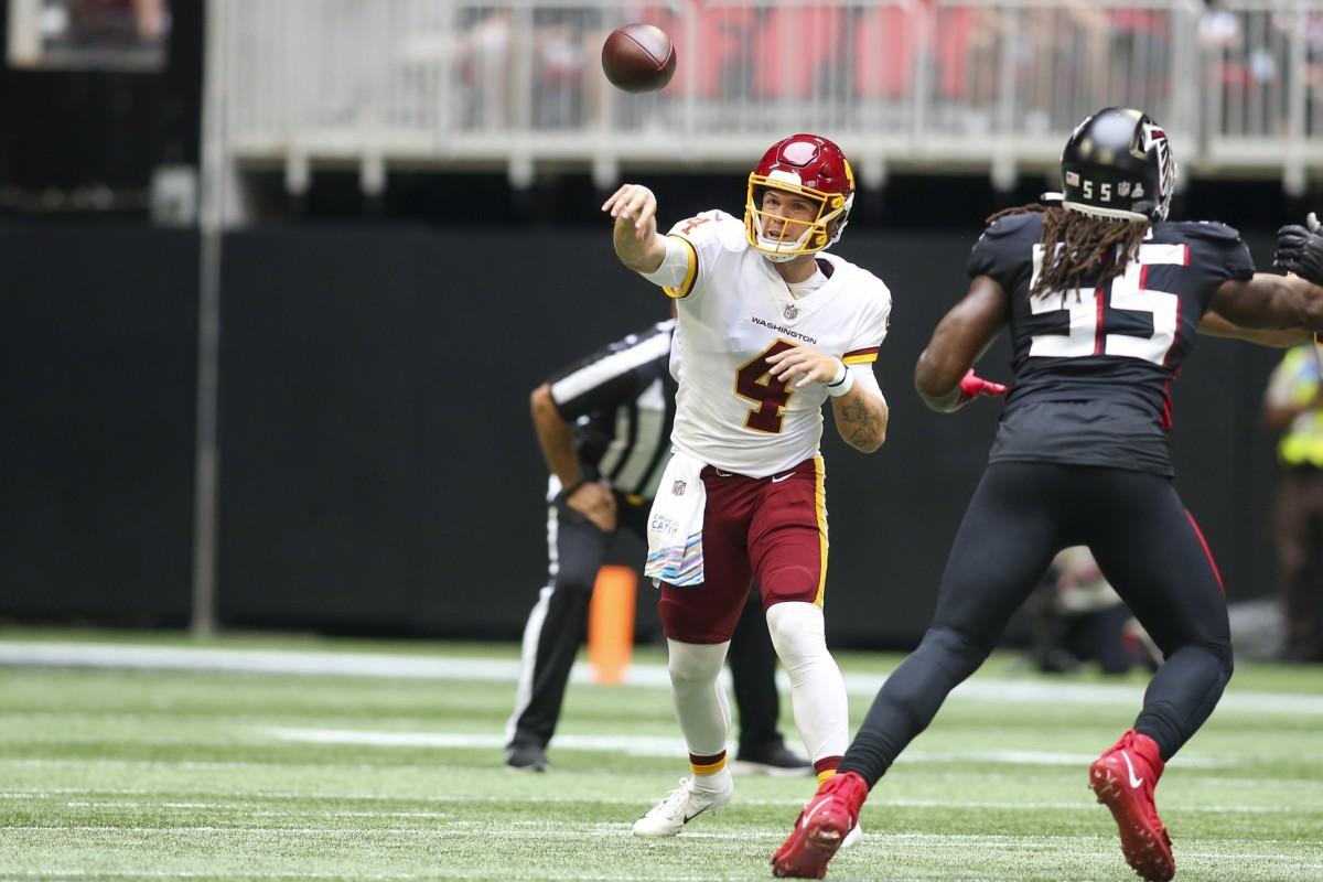 Washington quarterback Taylor Heinicke (4) throws a pass against the Atlanta Falcons. Mandatory Credit: Brett Davis-USA TODAY Sports