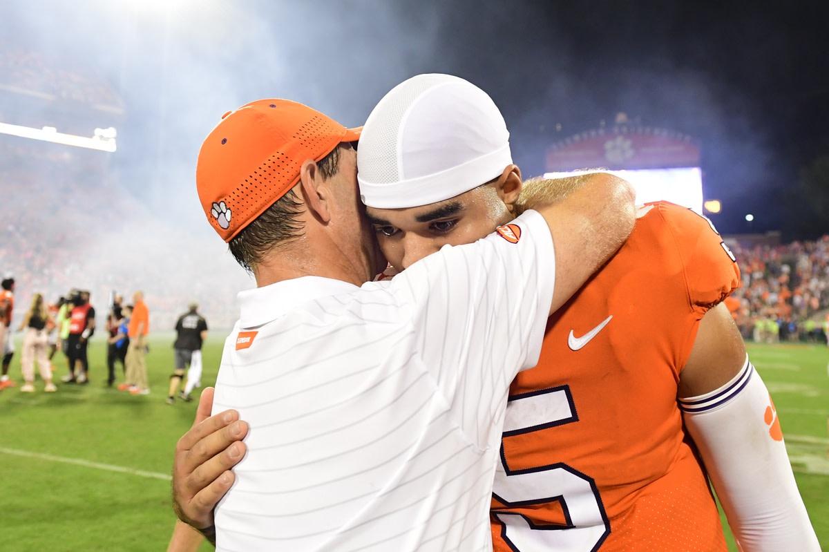 Oct 2, 2021; Clemson, South Carolina, USA; Clemson Tigers head coach Dabo Swinney hugs Clemson Tigers quarterback D.J. Uiagalelei (5) after the game against the Boston College Eagles at Memorial Stadium. Mandatory Credit: Adam Hagy-USA TODAY Sports