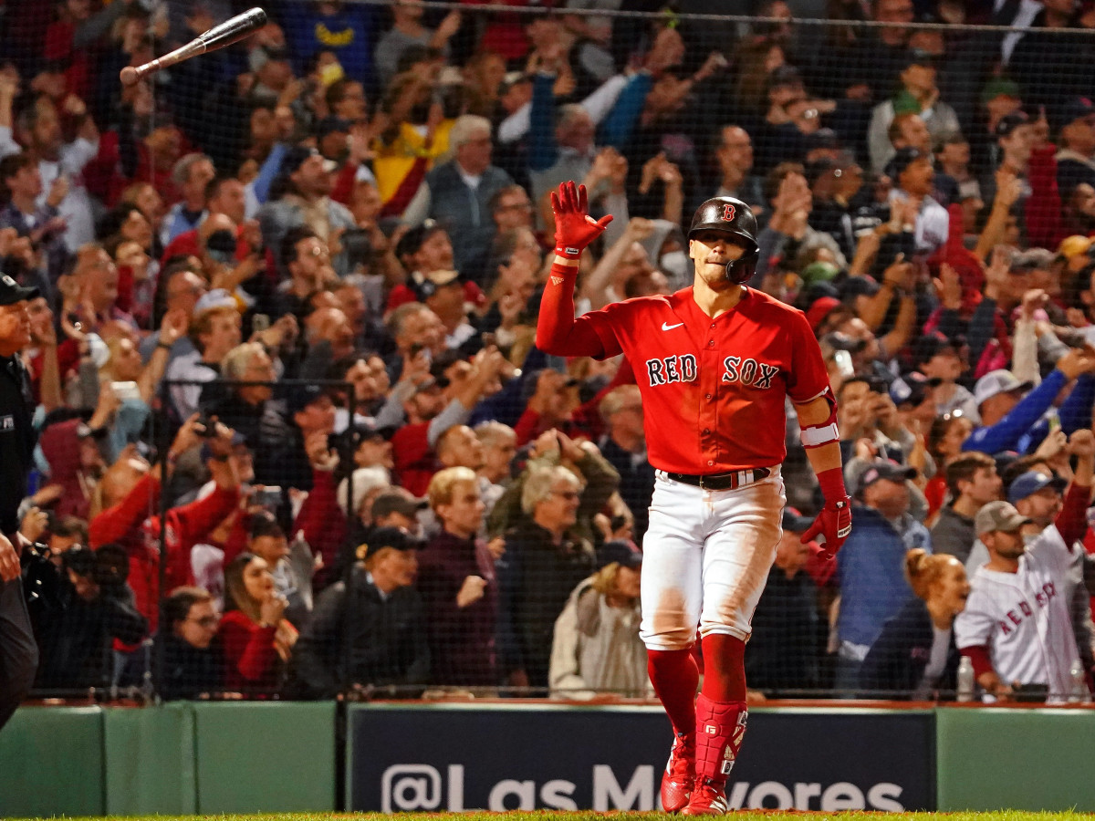 Boston Red Sox center fielder Enrique Hernandez (5) flips his bat after hitting a walk-off sacrifice fly against the Tampa Bay Rays to score pinch runner Danny Santana (not pictured) during the ninth inning of Game 4 of the ALDS