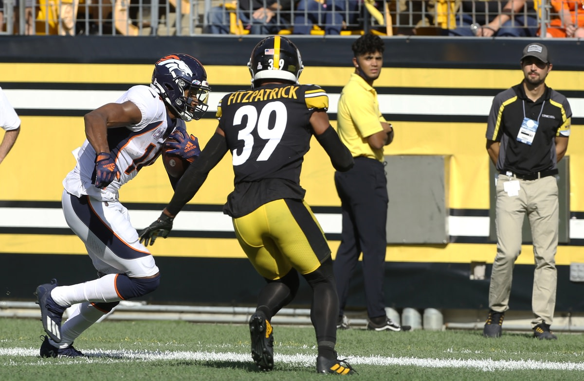 Oct 10, 2021; Pittsburgh, Pennsylvania, USA; Denver Broncos wide receiver Courtland Sutton (14) runs after a catch against Pittsburgh Steelers free safety Minkah Fitzpatrick (39) during the fourth quarter at Heinz Field. The Steelers won 27-19. Mandatory Credit: Charles LeClaire-USA TODAY Sports