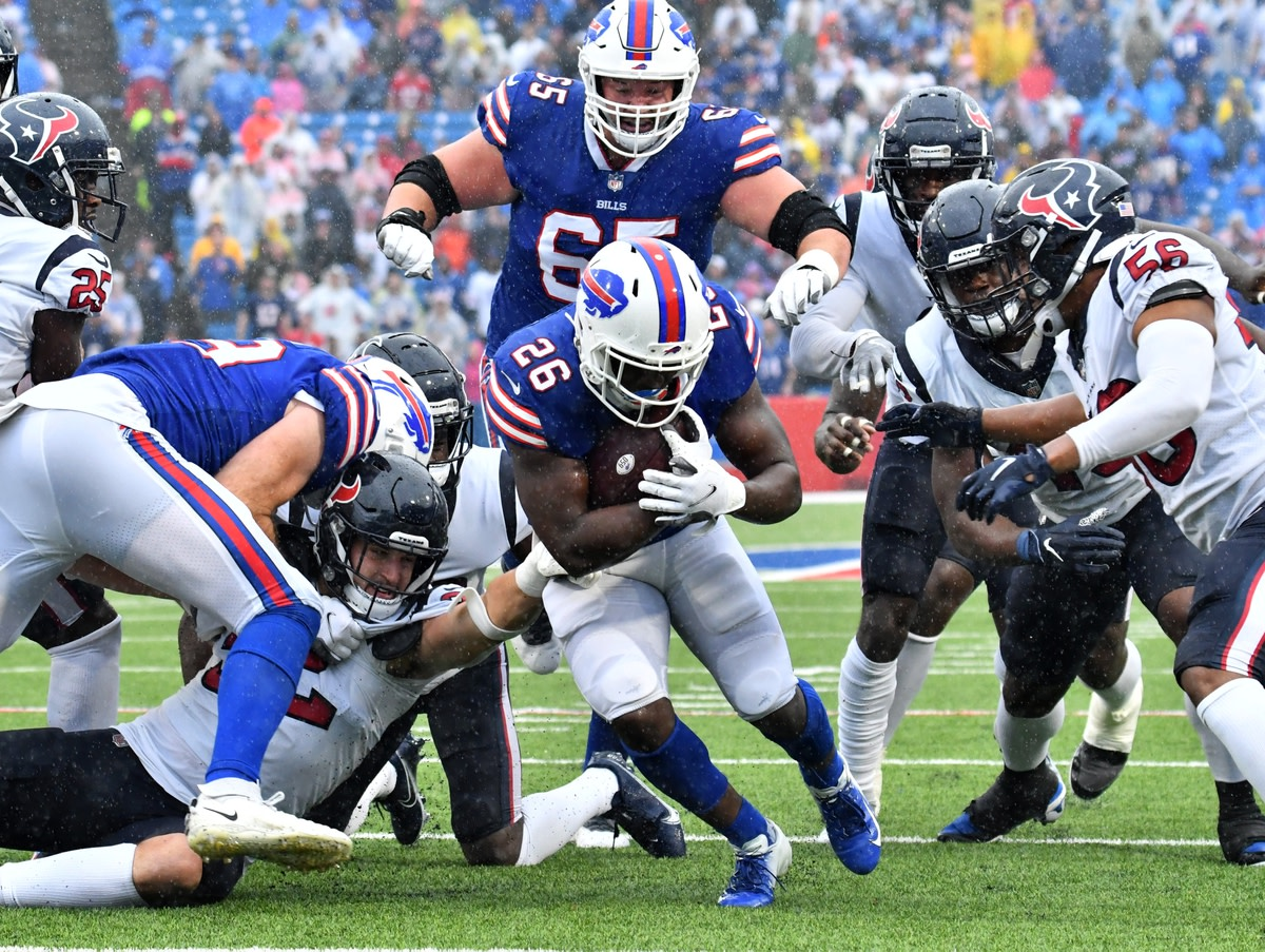 Oct 3, 2021; Orchard Park, New York, USA; Buffalo Bills running back Devin Singletary (26) finds a hole to run against the Houston Texans in the fourth quarter at Highmark Stadium. Mandatory Credit: Mark Konezny-USA TODAY Sports
