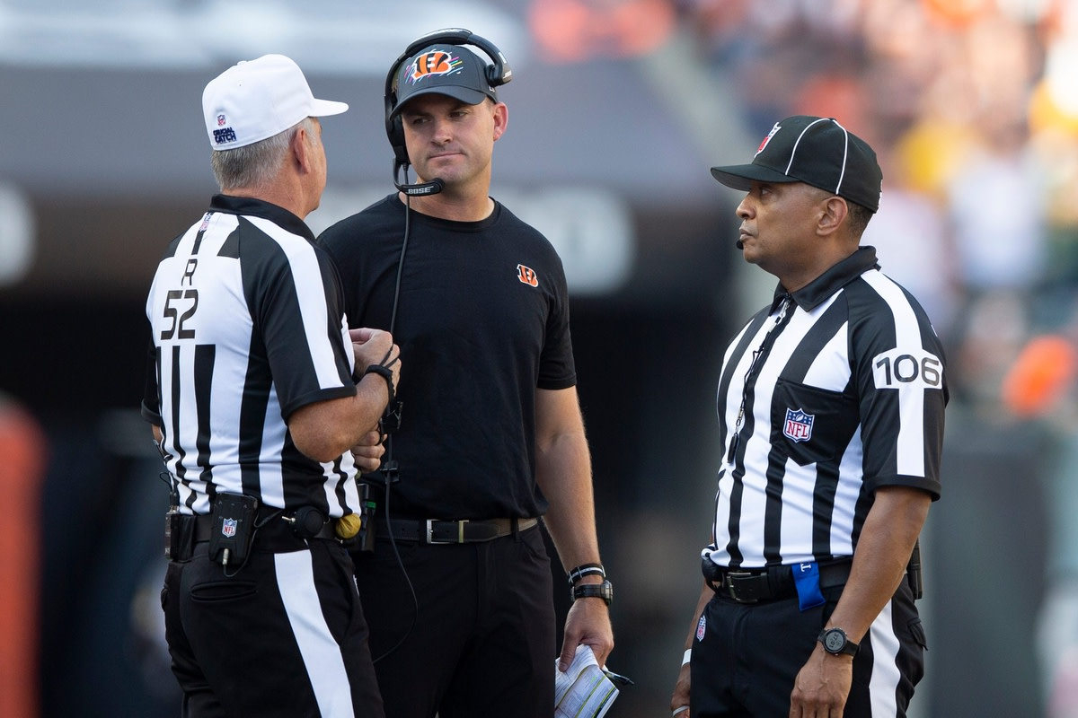Cincinnati Bengals head coach Zac Taylor speaks to a referee in the second half of the NFL football game on Sunday, Oct. 10, 2021, at Paul Brown Stadium in Cincinnati. Green Bay Packers defeated Cincinnati Bengals 25-22 in overtime.  Green Bay Packers At Cincinnati Bengals 66