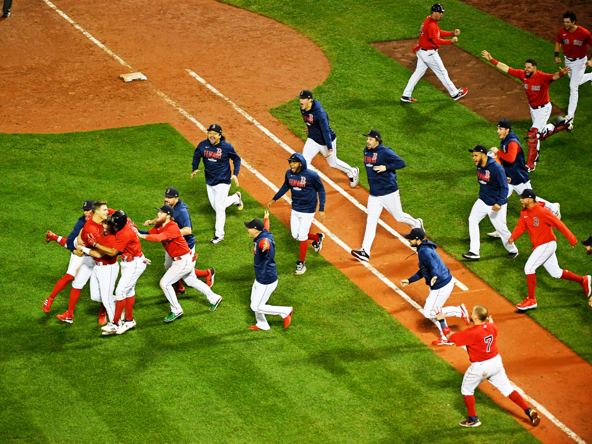 Oct 11, 2021; Boston, Massachusetts, USA; The Boston Red Sox celebrate their win over the Tampa Bay Rays in game four of the 2021 ALDS at Fenway Park. The Boston Red Sox won 6-5.