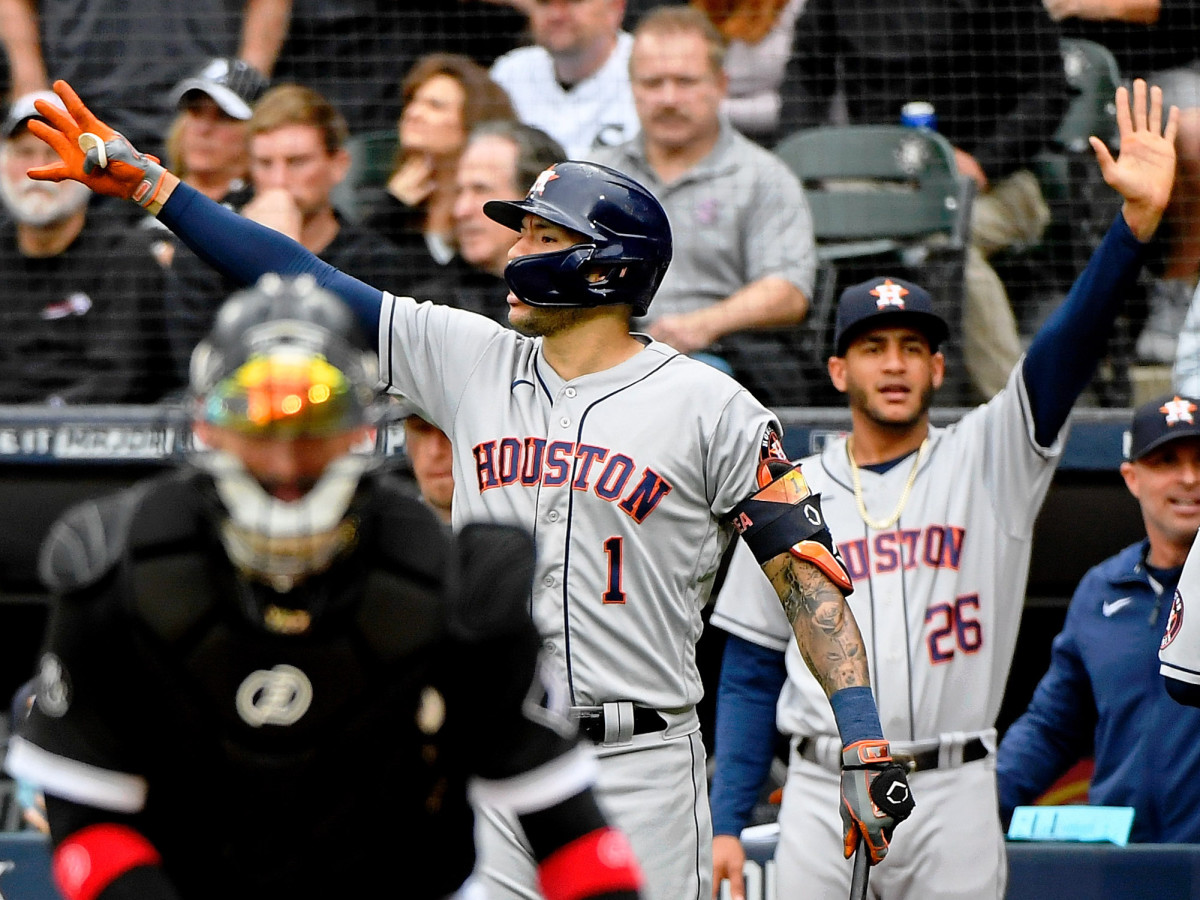 Houston Astros shortstop Carlos Correa (1) celebrates after third baseman Alex Bregman (not pictured) hit a two-run RBI double against the Chicago White Sox