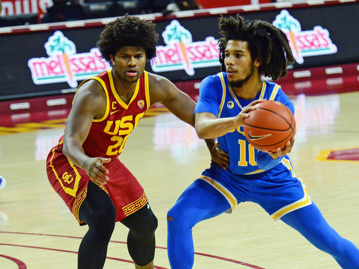 UCLA's Tyger Campbell goes against USC's Ethan Anderson