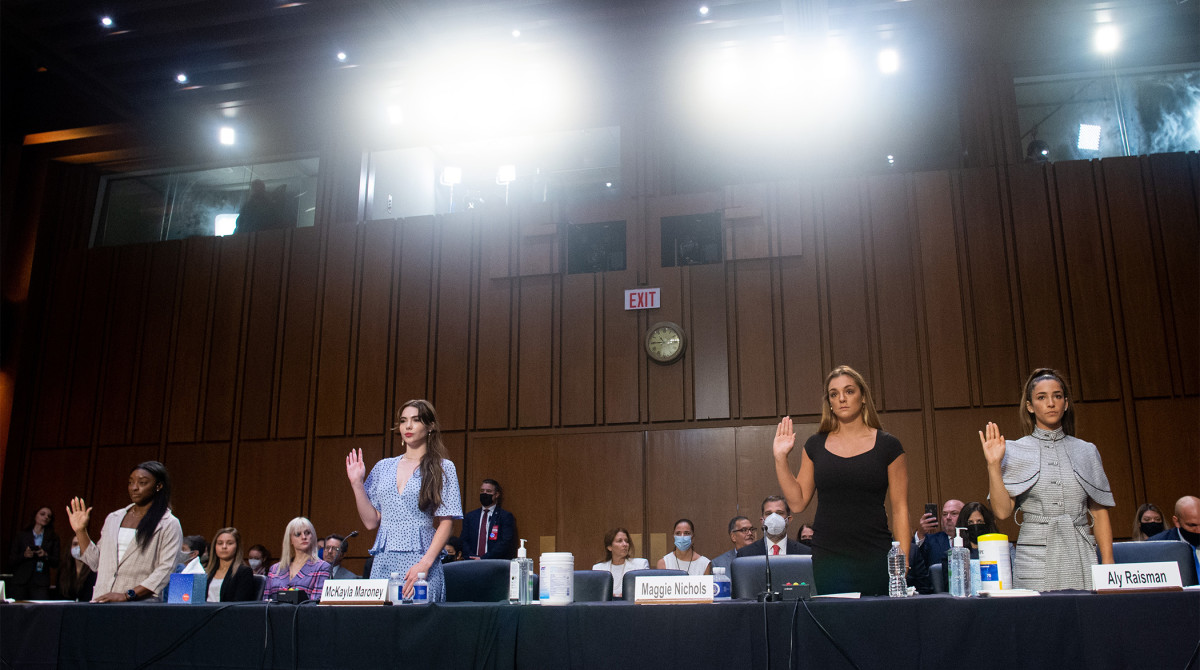 US Olympic gymnasts Simone Biles, McKayla Maroney, Maggie Nichols, and Aly Raisman, are sworn in to testify during a Senate Judiciary hearing about the Inspector General's report on the FBI handling of the Larry Nassar investigation of sexual abuse of Olympic gymnasts, on Capitol Hill, September 15, 2021, in Washington, DC.