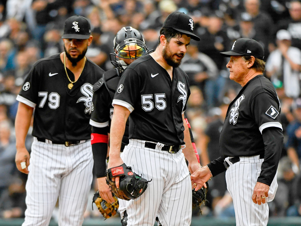 Oct 12, 2021; Chicago, Illinois, USA; Chicago White Sox starting pitcher Carlos Rodon (55) is taken out of the game against the Houston Astros by manager Tony La Russa (22) during the third inning in game four of the 2021 ALDS at Guaranteed Rate Field.