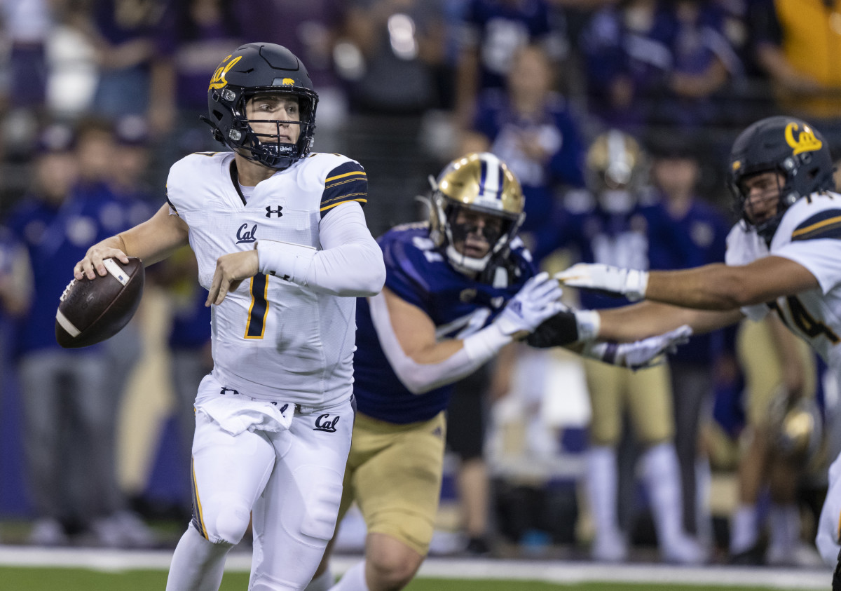 California Golden Bears quarterback Chase Garbers (7) scrambles out of the pocket during the second half against the Washington Huskies at Alaska Airlines Field at Husky Stadium.
