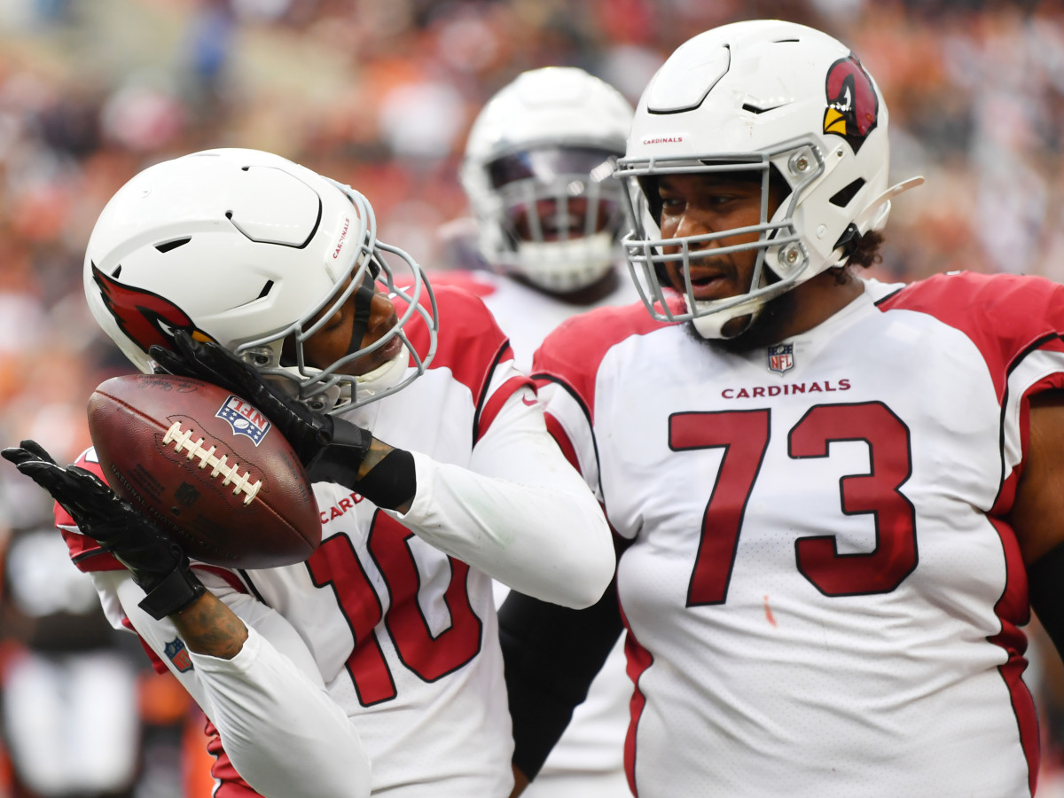 Arizona Cardinals wide receiver DeAndre Hopkins (10) celebrates with guard Max Garcia (73) after catching a touchdown pass during the first half against the Cleveland Browns at FirstEnergy Stadium.