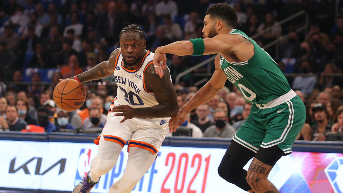 New York Knicks forward Julius Randle drives to the basket against Boston Celtics forward Jayson Tatum.