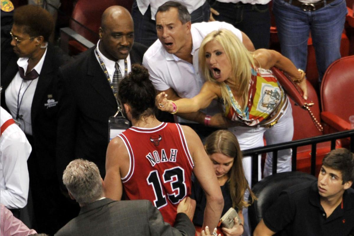 Joakim Noah greeted by a Miami fan.