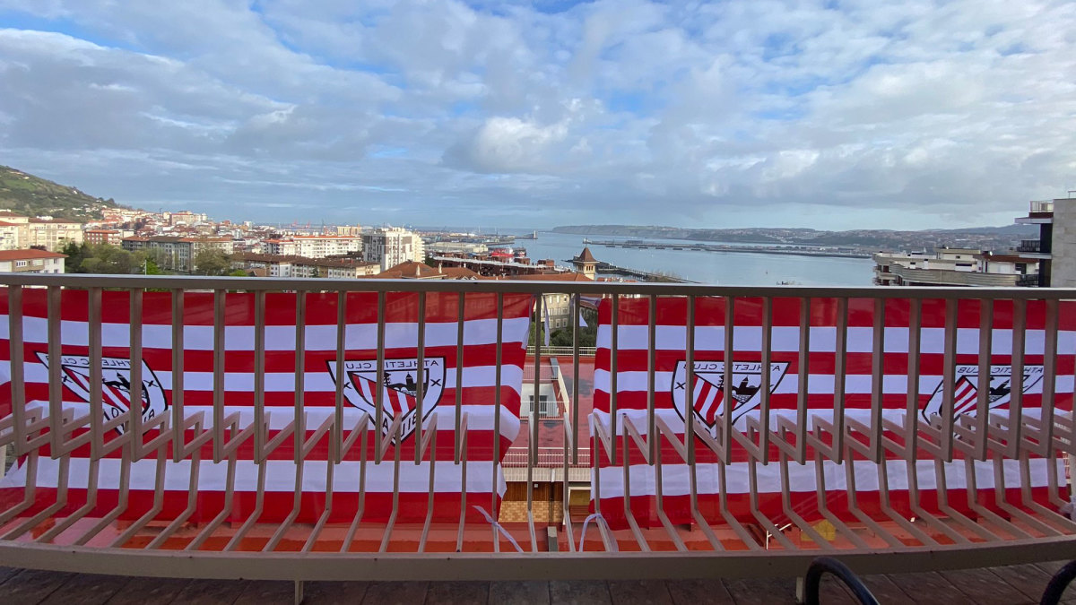 Athletic Bilbao banners hang on city balconies in anticipation of two Copa del Rey finals