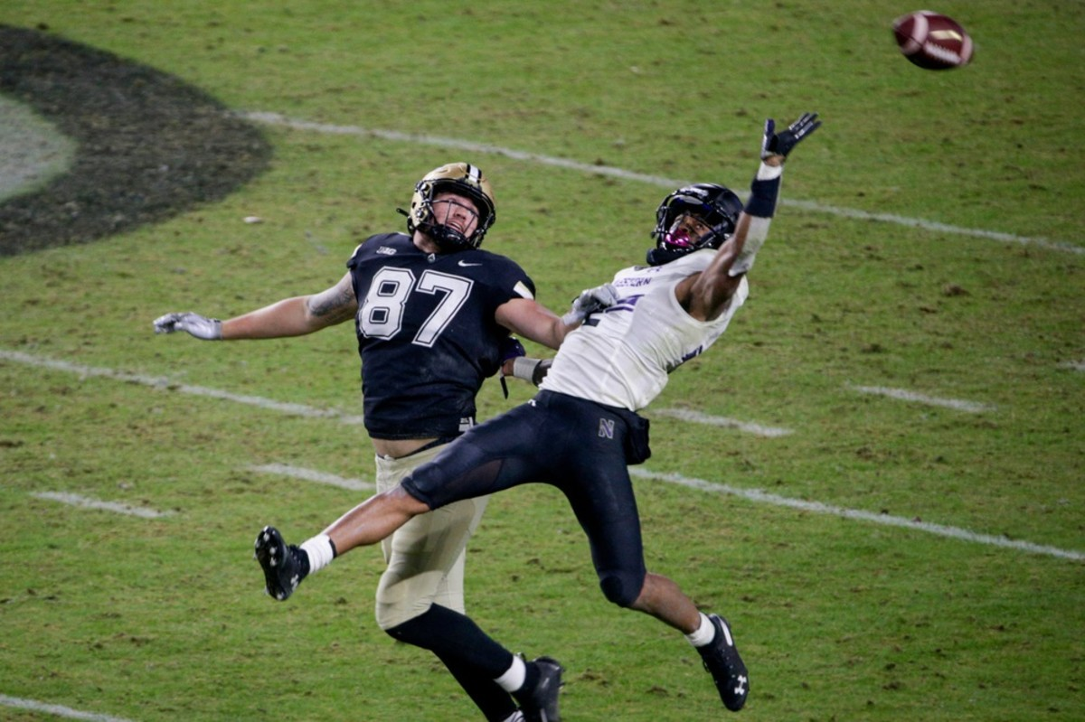 Purdue tight end Payne Durham (87) and Northwestern defensive back Greg Newsome II (2) reach for a pass during the fourth quarter of a NCAA football game. Mandatory Credit: Nikos Frazier-USA TODAY