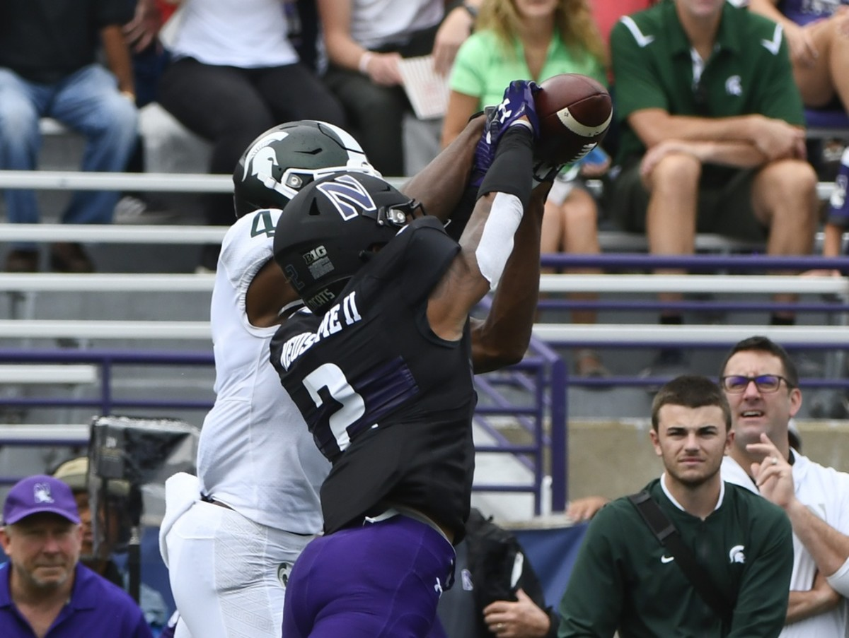 Northwestern Wildcats defensive back Greg Newsome II (2) breaks up a pass meant for Michigan State receiver C.J. Hayes (4). Mandatory Credit: Matt Marton-USA TODAY