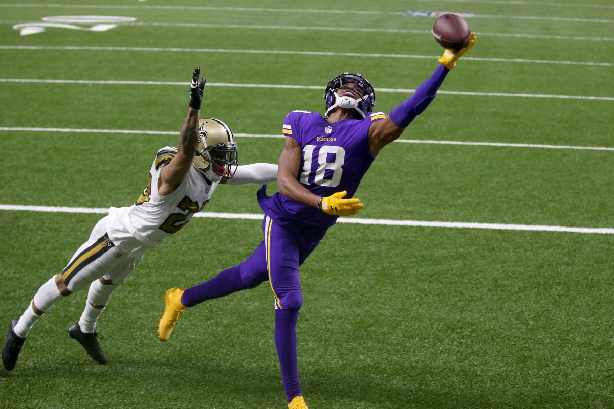 Minnesota receiver Justin Jefferson (18) can't catch a 2-point conversion attempt in the fourth quarter while defended by New Orleans Saints cornerback Marshon Lattimore (23). Mandatory Credit: Chuck Cook-USA TODAY