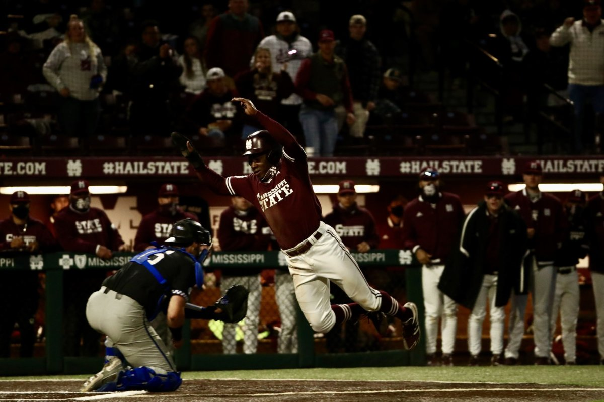 Mississippi State's Brayland Skinner evades the tag at home plate and scores MSU's first run on Friday night. The Bulldogs went on to win 3-2 over Kentucky. (Photo courtesy of Mississippi State athletics)