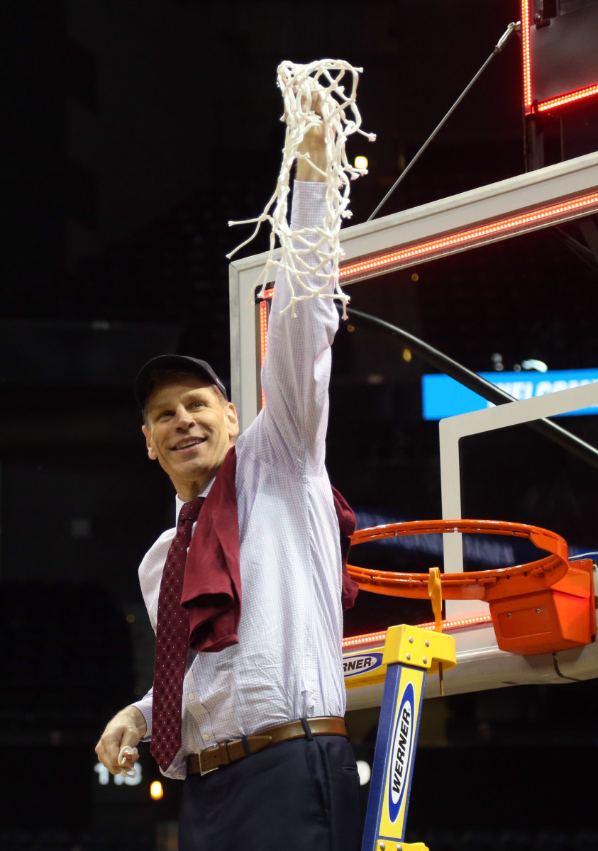 Porter Moser cuts down the nets
