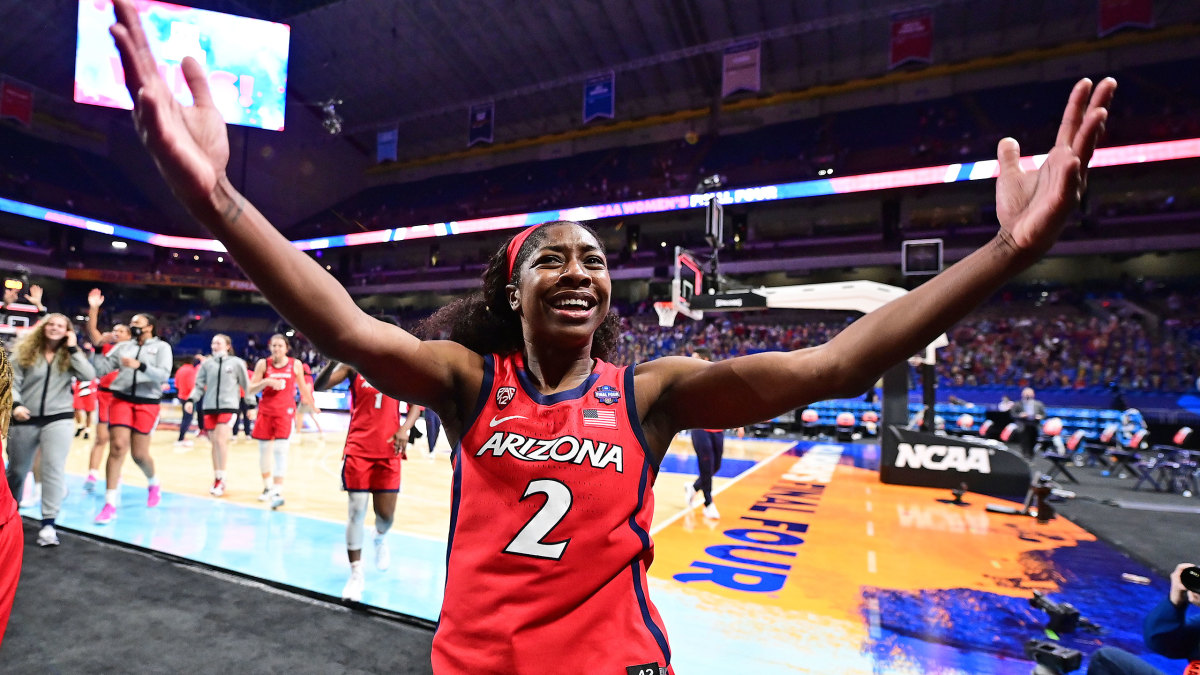 Aari McDonald throws up her arms in celebration after beating UConn