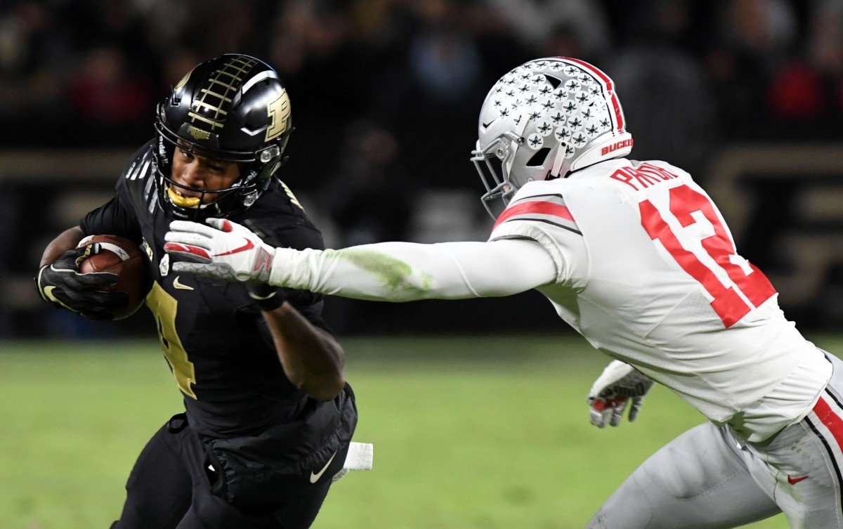 Purdue Boilermaker receiver Rondale Moore (4) evades Ohio State safety Isaiah Pryor (12). Mandatory Credit: Thomas J. Russo-USA TODAY