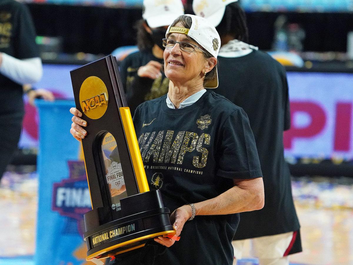 Stanford coach Tara VanDerveer poses with the trophy