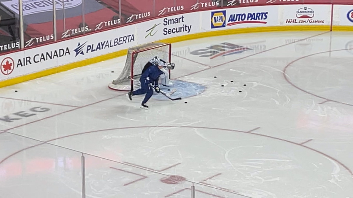 Toronto Maple Leafs goaltender Jack Campbell works on drills with goalie coach Steve Briere in Calgary.