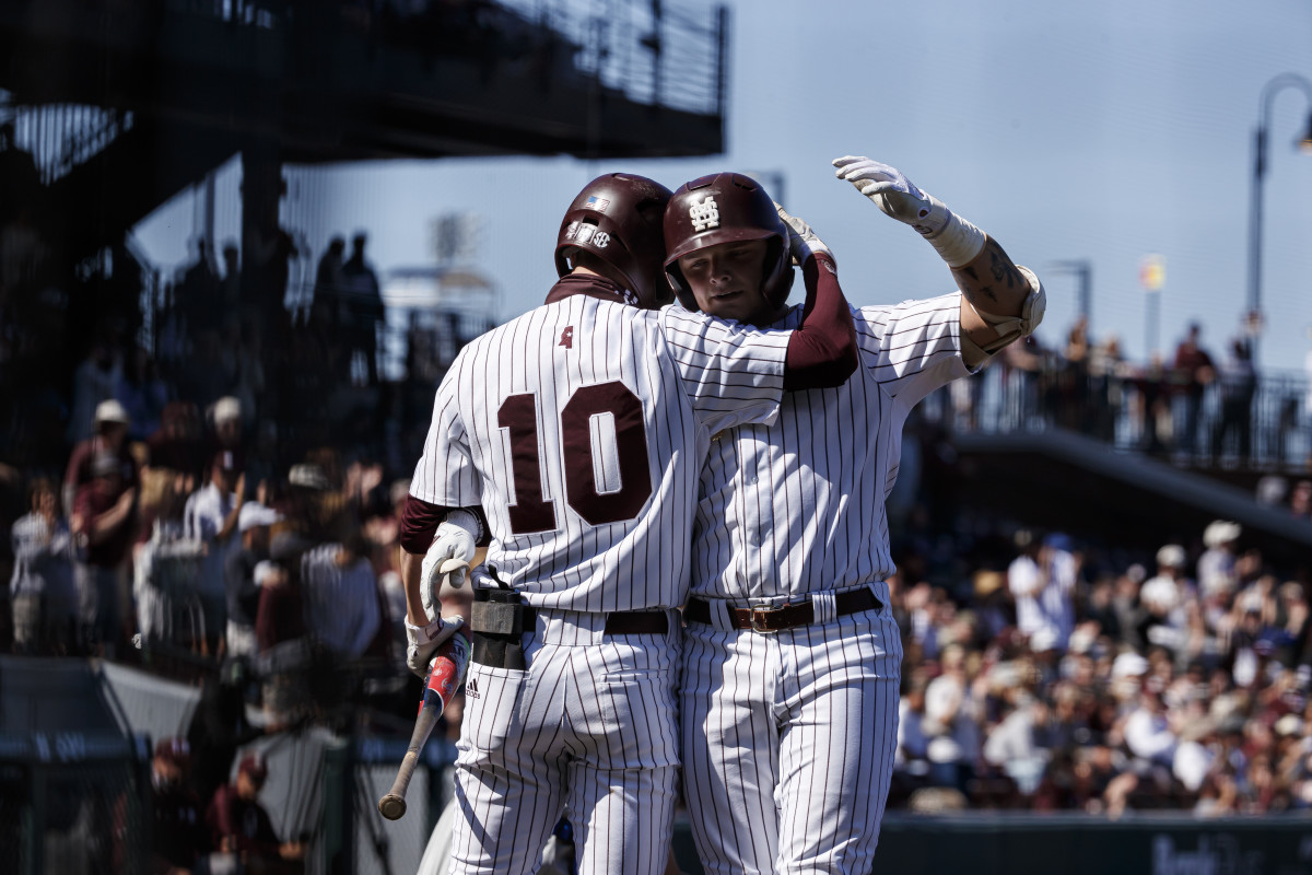 Josh Hatcher, No. 10, and Logan Tanner celebrate on Saturday after Tanner touches home plate. (Photo courtesy of Mississippi State athletics)