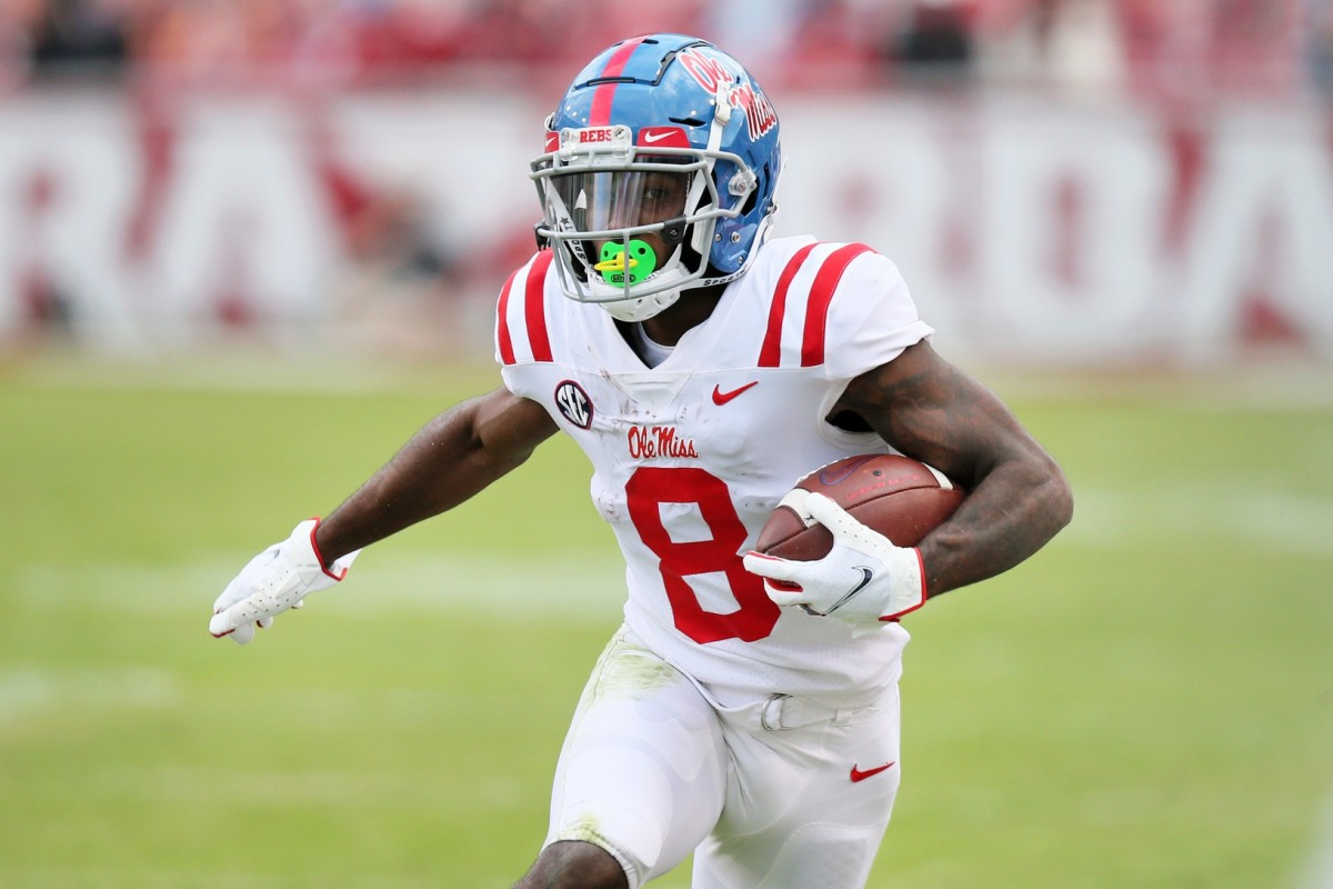 Ole Miss Rebels wide receiver Elijah Moore (8) runs after a catch against the Arkansas Razorbacks. Mandatory Credit: Nelson Chenault-USA TODAY Sports