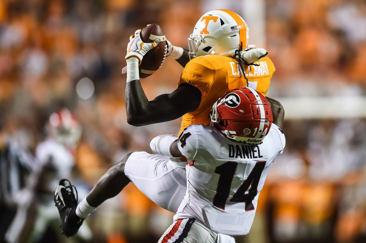 Tennessee Volunteers wide receiver Marquez Callaway (1) makes a catch over Georgia Bulldogs defensive back DJ Daniel (14) during the first quarter at Neyland Stadium.
