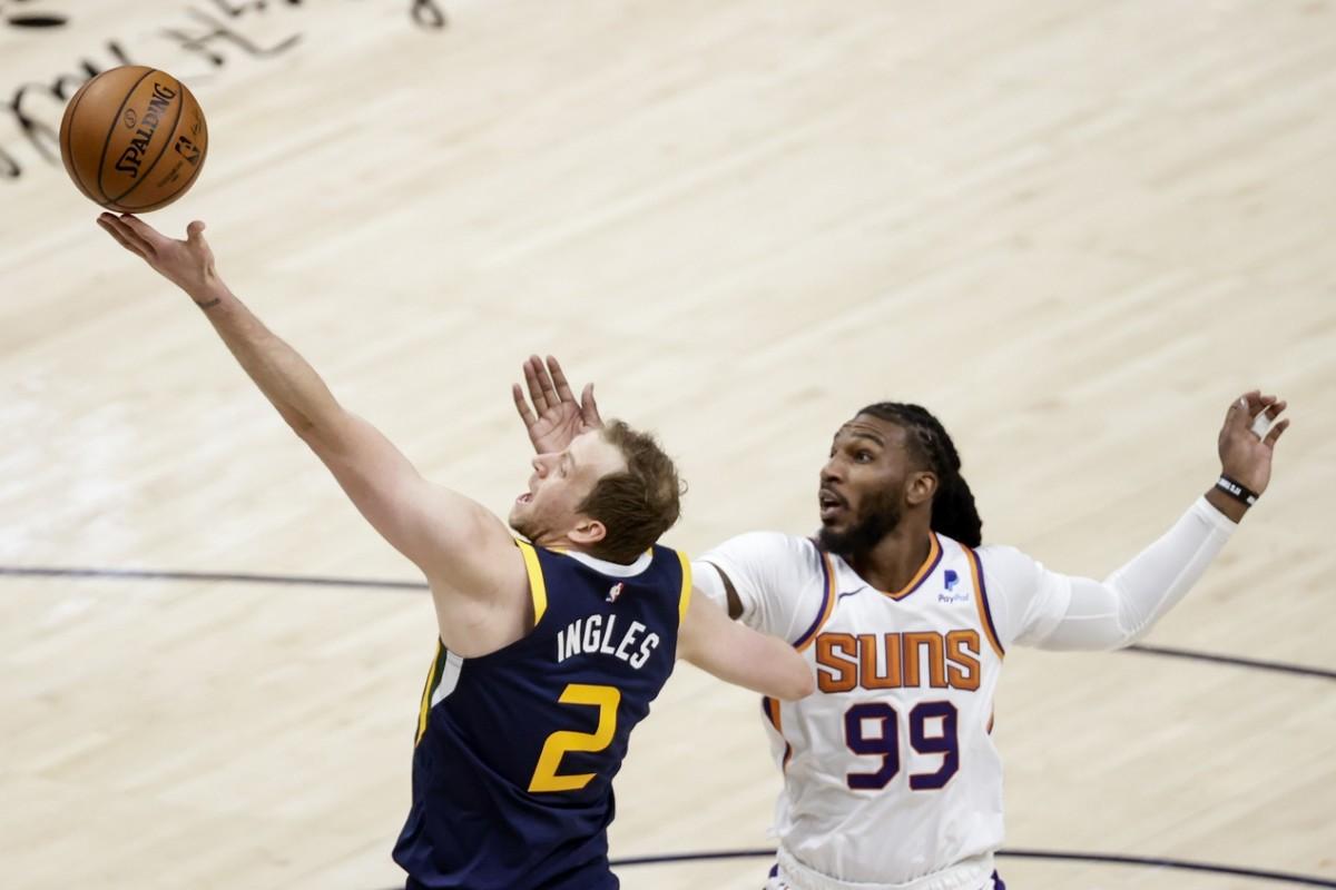 Joe Ingles (2) shoots a layup over Jae Crowder (99) and the Phoenix Suns