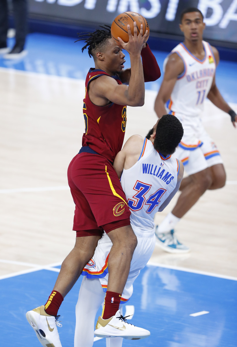 Kenrich Williams sets up to take a charge on the defensive end of the floor