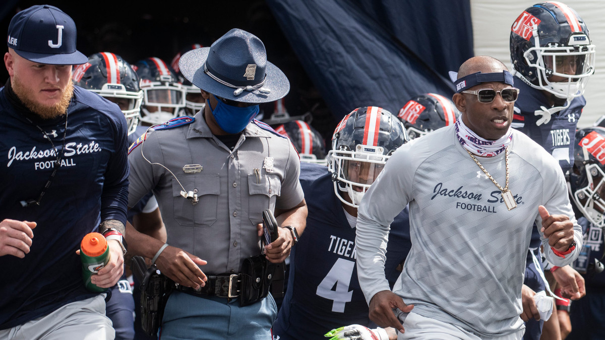 Deion Sanders runs out of the tunnel