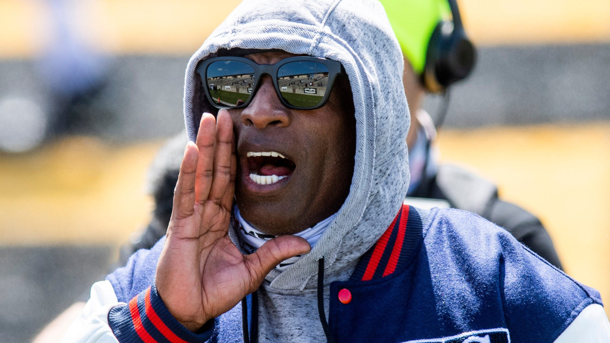 Deion Sanders yell instructions from the sideline