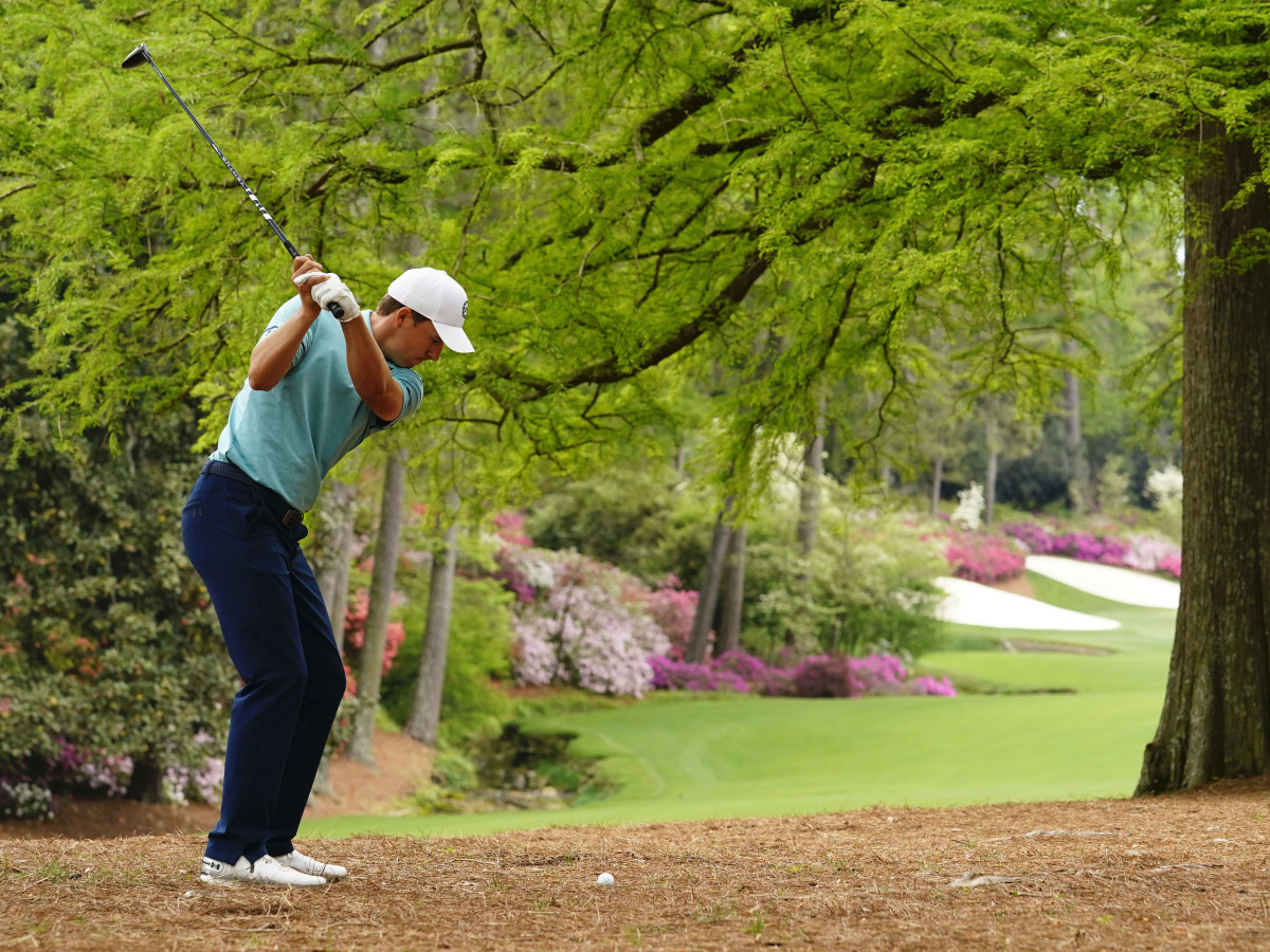 Jordan Spieth hits a shot out of the pine straw on the 13th hole of the Masters at Augusta National.