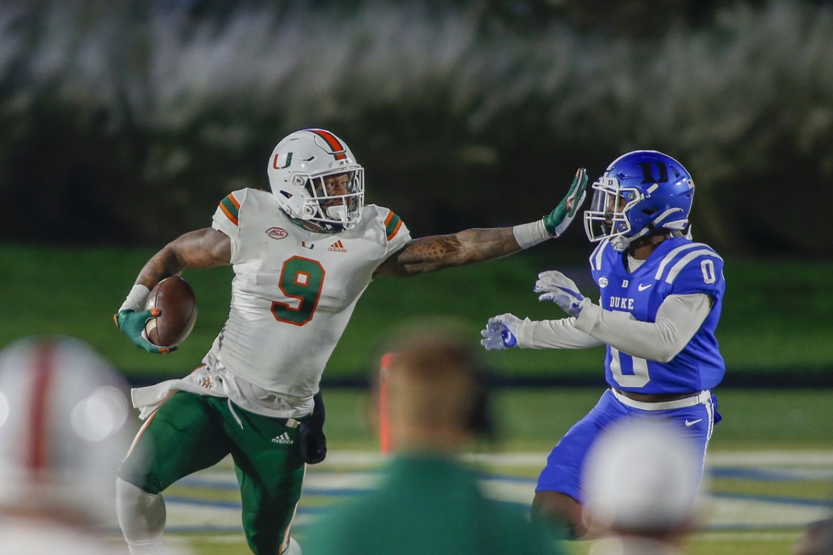 Miami Hurricanes tight end Brevin Jordan (9) carries the football against Duke safety Marquis Waters (0). Mandatory Credit: Nell Redmond-USA TODAY