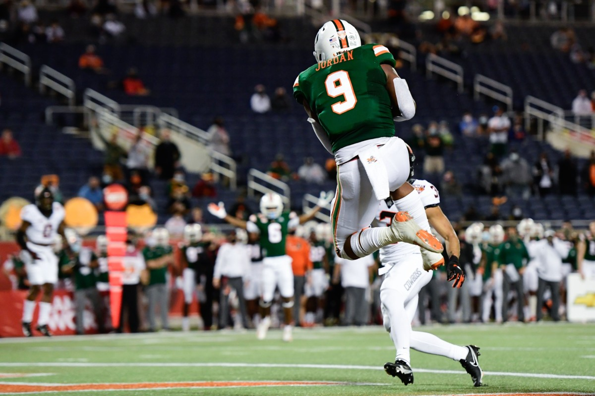 Miami Hurricanes tight end Brevin Jordan (9) makes a reception for a touchdown against Oklahoma State during the Cheez-It Bowl Game. Mandatory Credit: Douglas DeFelice-USA TODAY