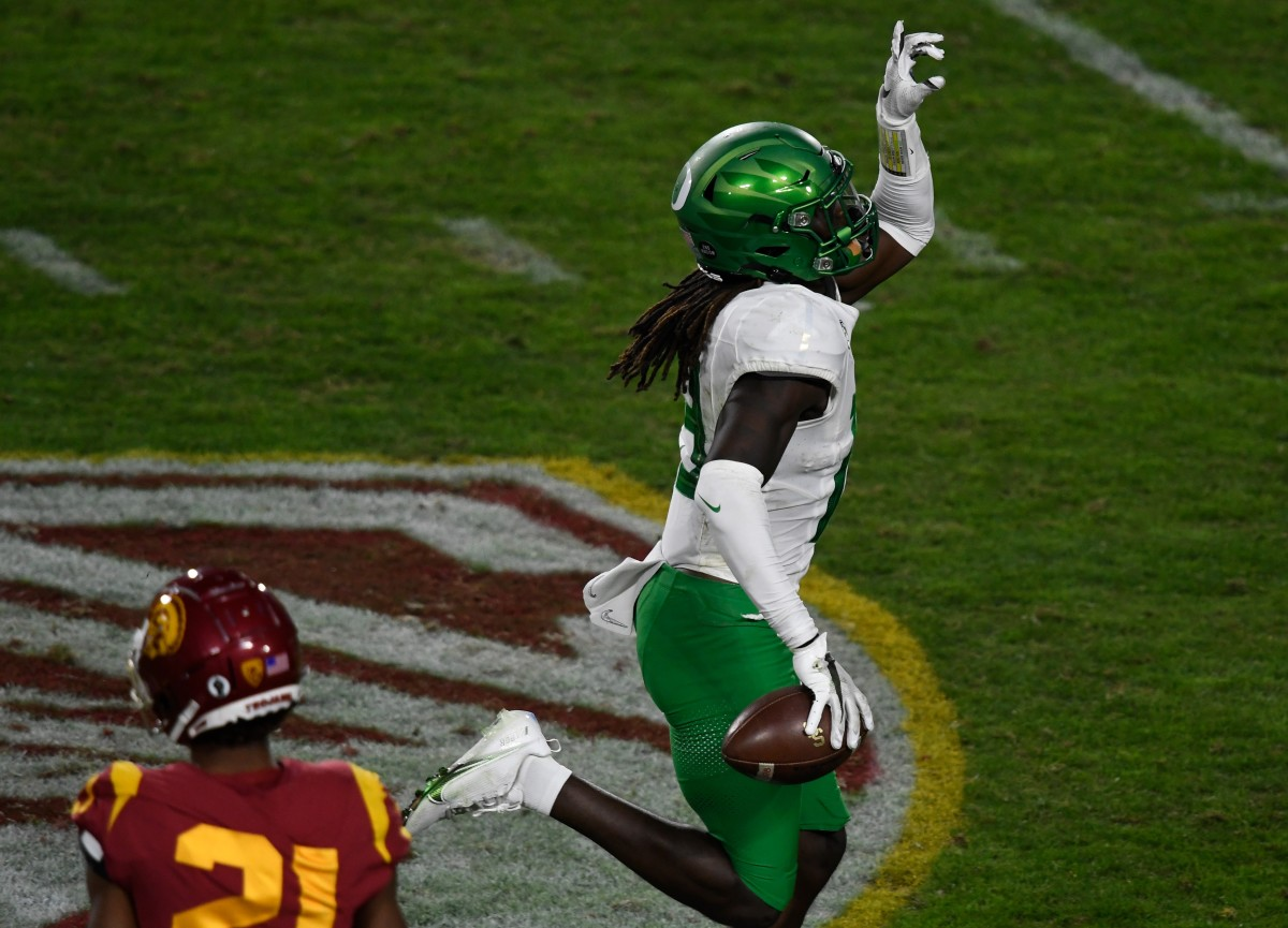 Jamal Hill celebrates one of his two interceptions against USC in the 2020 Pac-12 Championship Game.