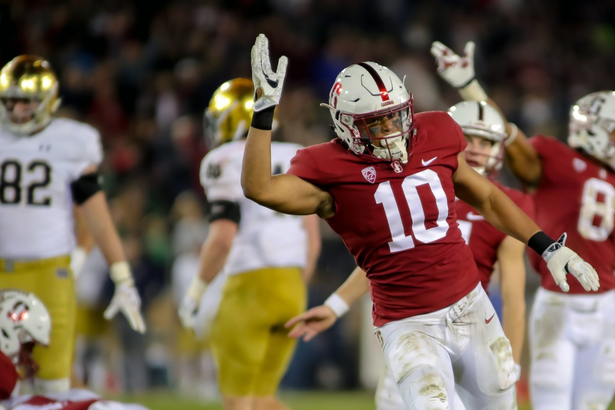 Stanford Cardinal linebacker Jordan Fox (10) celebrates after a fumble recovery against the Notre Dame Fighting Irish during the fourth quarter at Stanford Stadium.