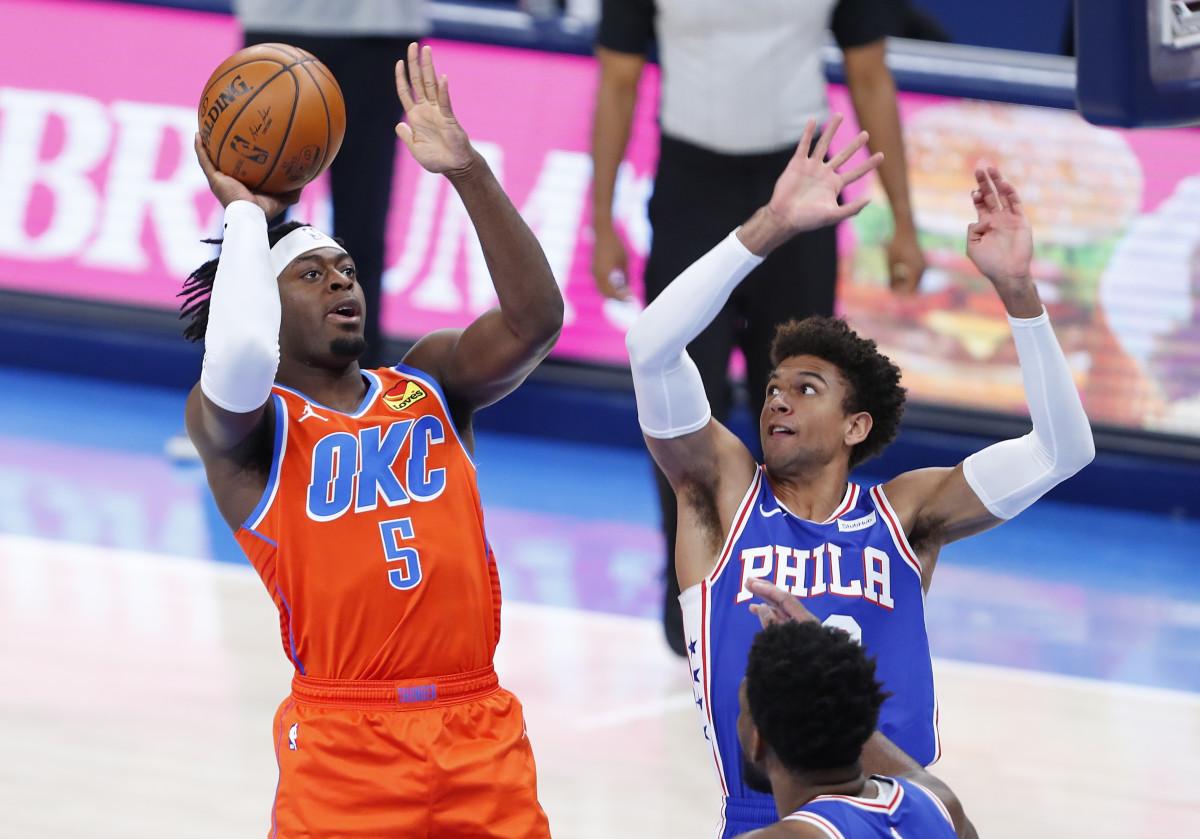 OKC's Luguentz Dort shoots the ball over Philadelphia's Matisse Thybulle