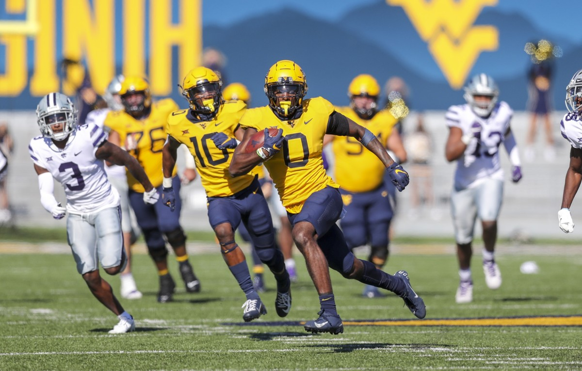 Oct 31, 2020; Morgantown, West Virginia, USA; West Virginia Mountaineers wide receiver Bryce Ford-Wheaton (0) runs after a catch during the second quarter against the Kansas State Wildcats at Mountaineer Field at Milan Puskar Stadium