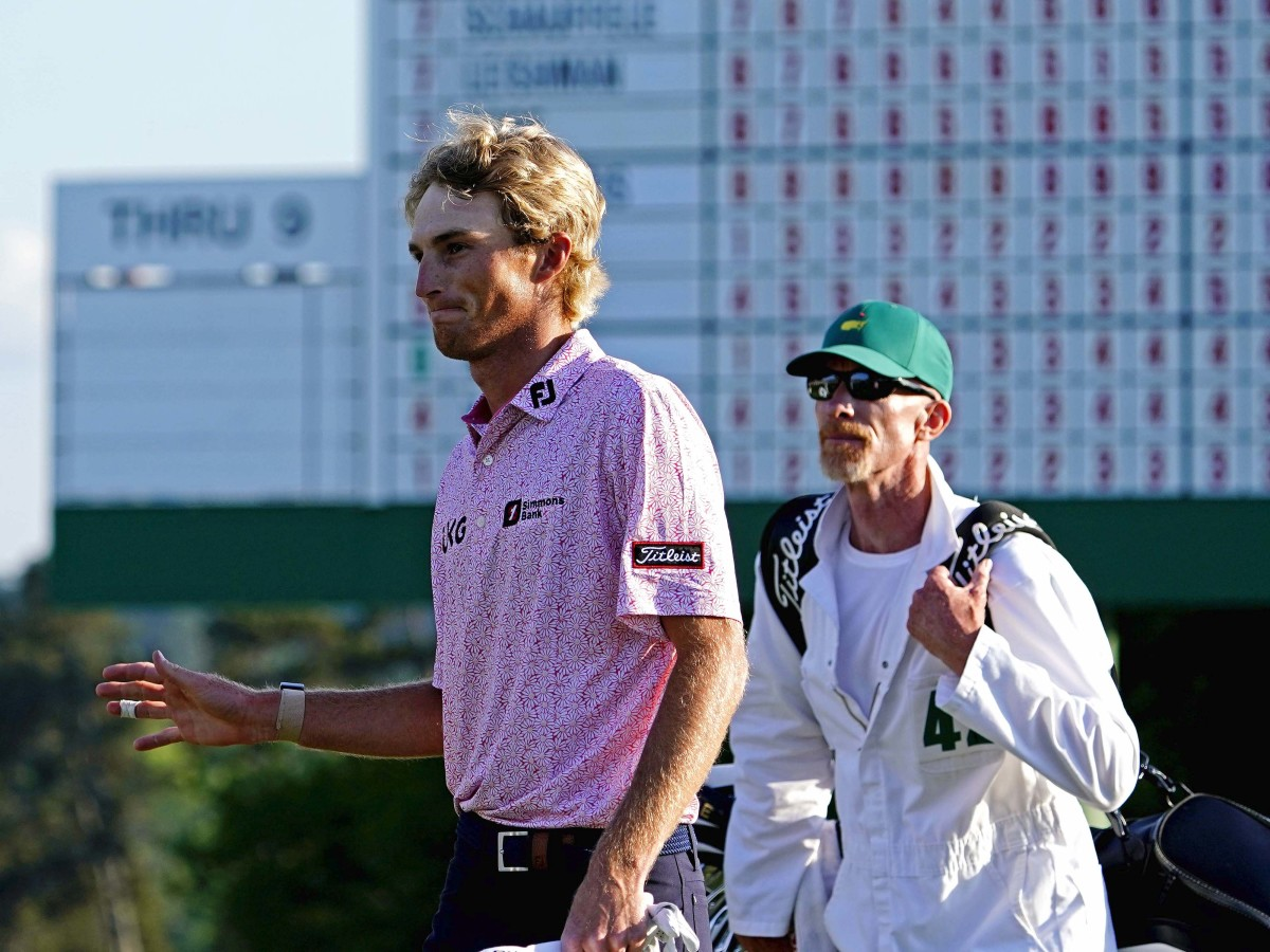 Will Zalatoris walks off the 18th green during the final round of The Masters golf tournament.