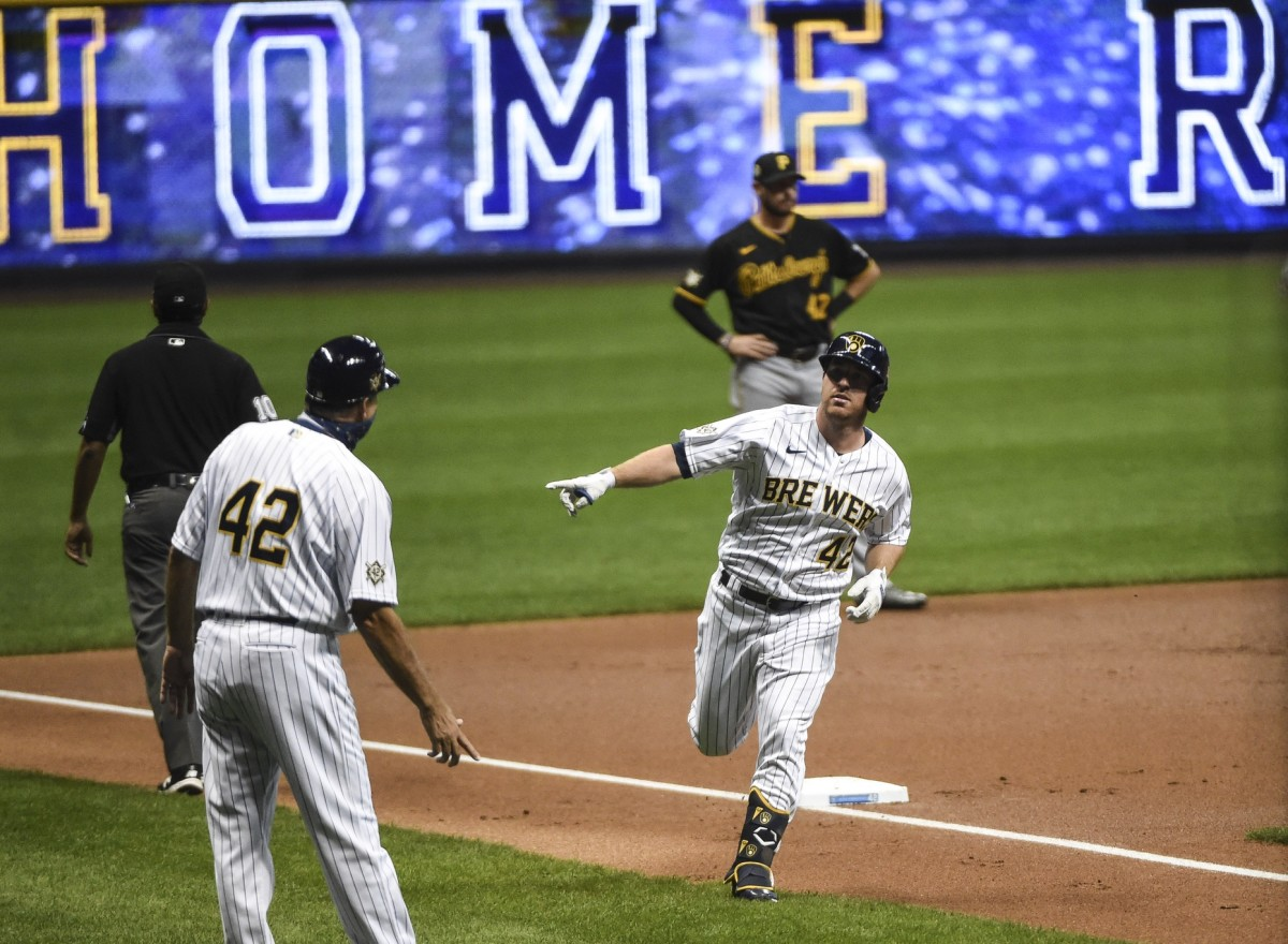 Aug 28, 2020; Milwaukee, Wisconsin, USA; Milwaukee Brewers third baseman Jedd Gyorko runs the bases after hitting a solo home run in the first inning against the Pittsburgh Pirates at Miller Park.