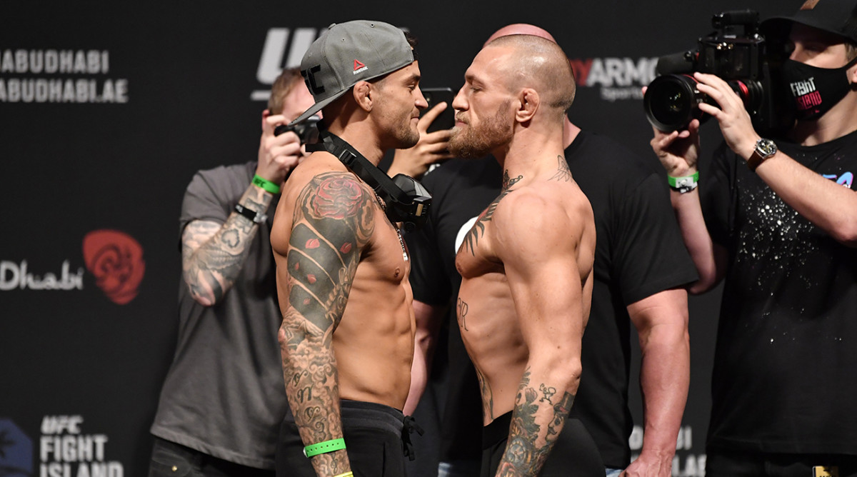 Conor McGregor and Dustin Poirier during the UFC 257 weigh-in.
