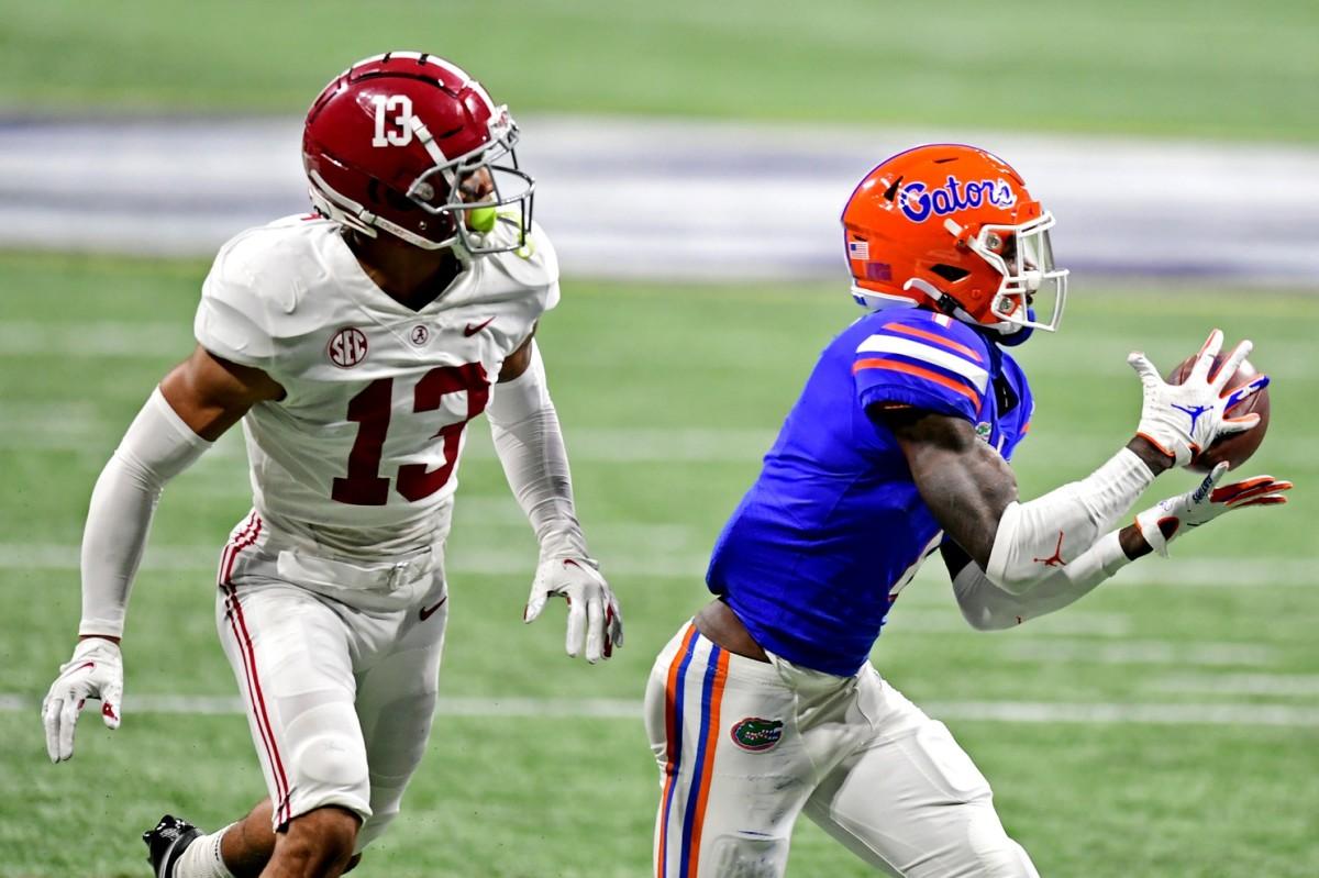 Florida Gators receiver Kadarius Toney (1) makes a catch against Alabama defensive back Malachi Moore in the SEC Championship. Mandatory Credit: Adam Hagy-USA TODAY Sports
