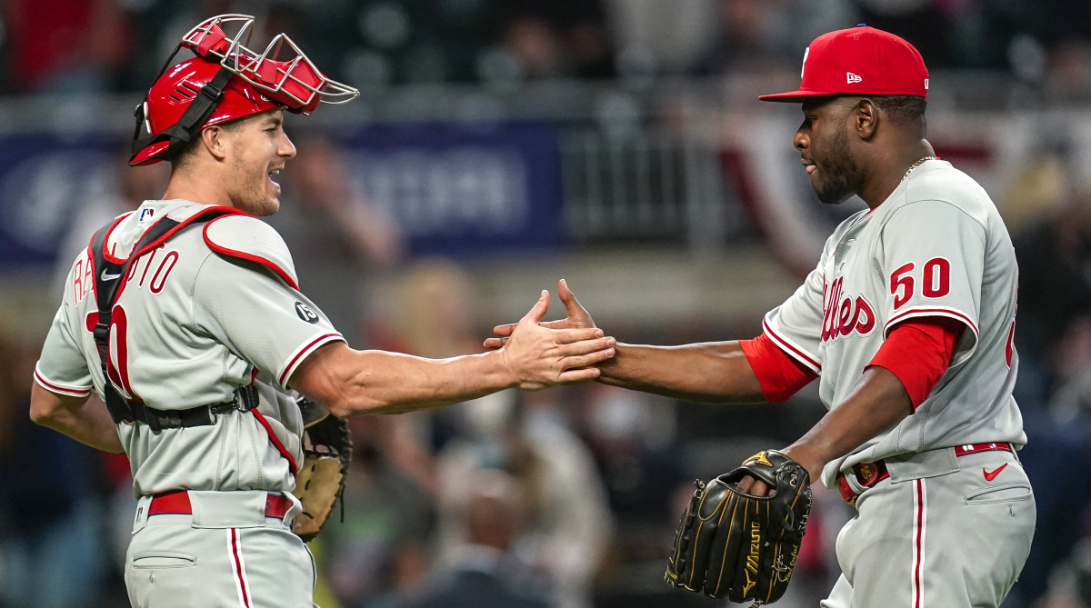 Phillies relief pitcher Héctor Neris celebrates with catcher J.T. Realmuto after beating the Braves.