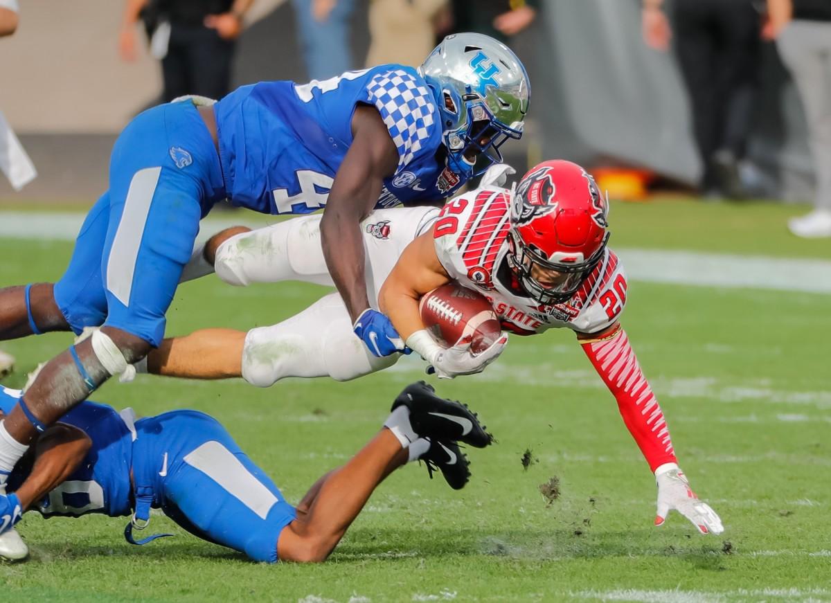 North Carolina State running back Jordan Houston (20) is tackled by Kentucky linebacker Jamin Davis (44). Mandatory Credit: Mike Watters-USA TODAY Sports