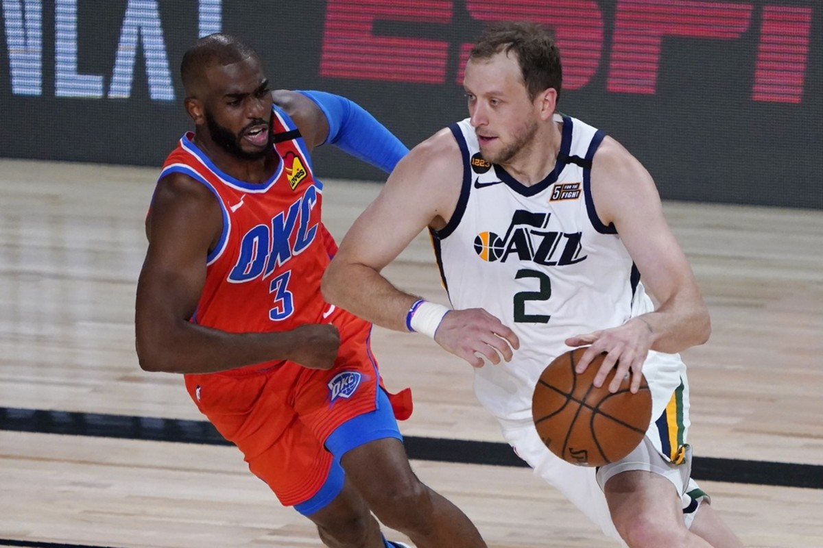 Joe Ingles (2) drives past Chris Paul (3) in a game against the Oklahoma City Thunder